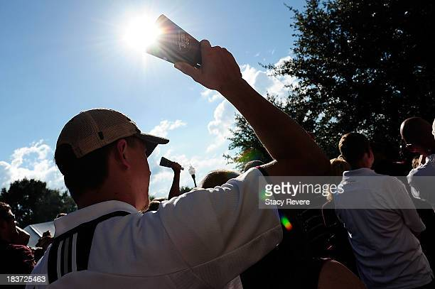 A fan of the Mississippi State Bulldogs shakes a cowbell prior to a game against the LSU Tigers at Davis Wade Stadium on October 5 2013 in Starkville...