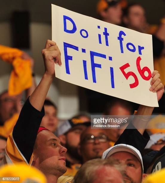 A fan of the Nashville Predators player Kevin Fiala holds up a sign during the first period in Game Three of the Western Conference Second Round...