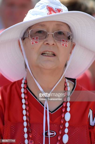 A fan of the Nebraska Cornhuskers awaits the arrival of the team before the game against the Rutgers Scarlet Knights at Memorial Stadium on September...