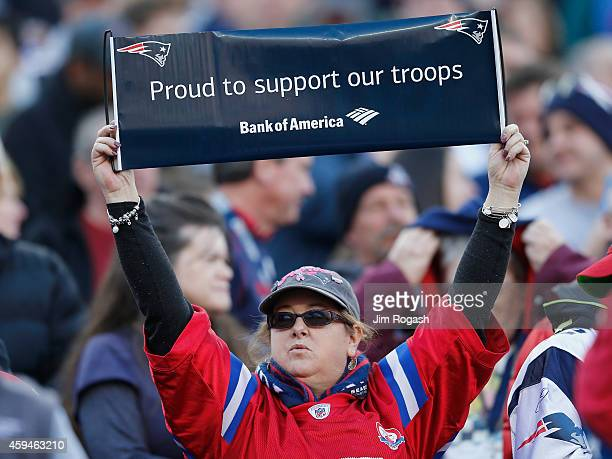 A fan of the New England Patriots holds a sign during the second quarter against the Detroit Lions at Gillette Stadium on November 23 2014 in Foxboro...