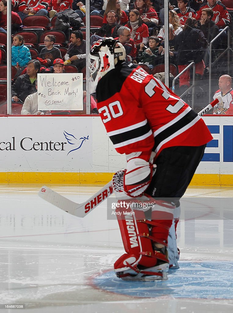 A fan of the New Jersey Devils shows a sign welcoming back goaltender Martin Brodeur #30 for his first home game after being activated off the injured reserve against the Florida Panthers during the game at the Prudential Center on March 23, 2013 in Newark, New Jersey.