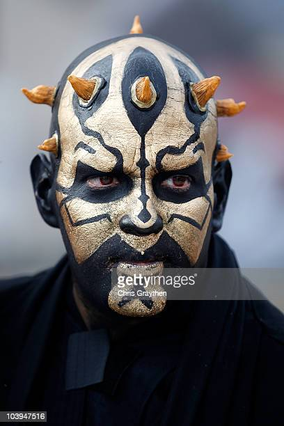 A fan of the New Orleans Saints shows support for his team by painting his face like 'Darth Maul' prior to the Saints playing against the Minnesota...