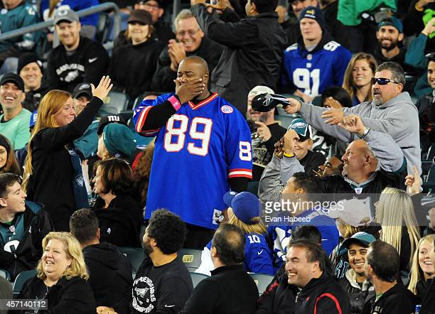 A fan of the New York Giants is taunted by fans of the Philadelphia Eagles during a football game at Lincoln Financial Field on October 12 2014 in...