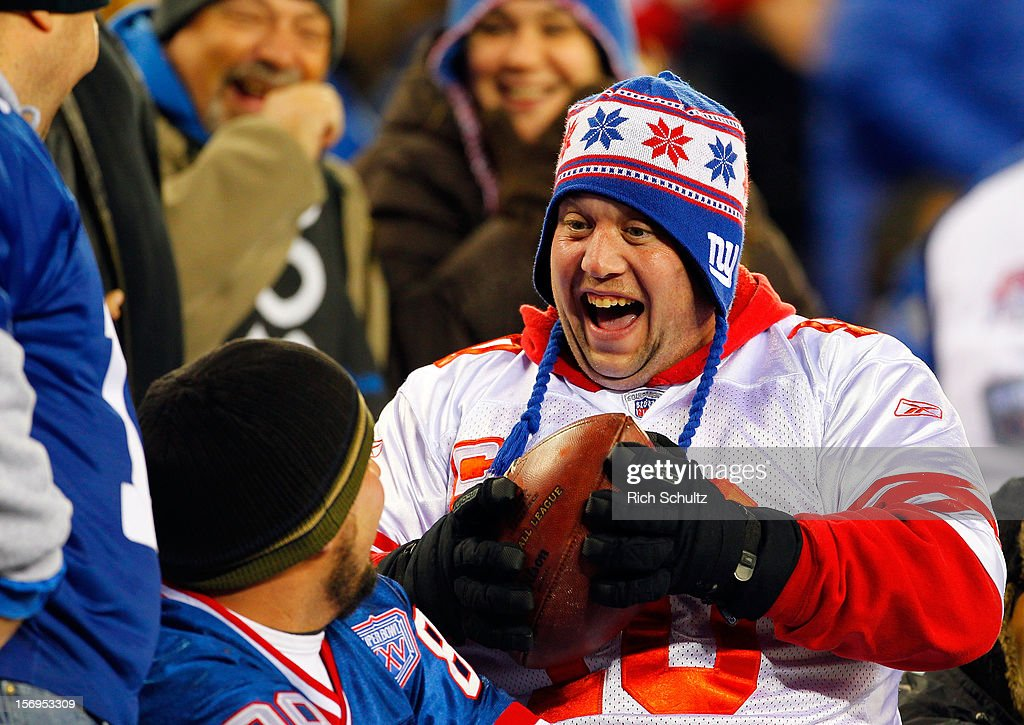 A fan of the New York Giants reacts after catching a ball that had been thrown into the stands at MetLife Stadium on November 25, 2012 in East Rutherford, New Jersey.