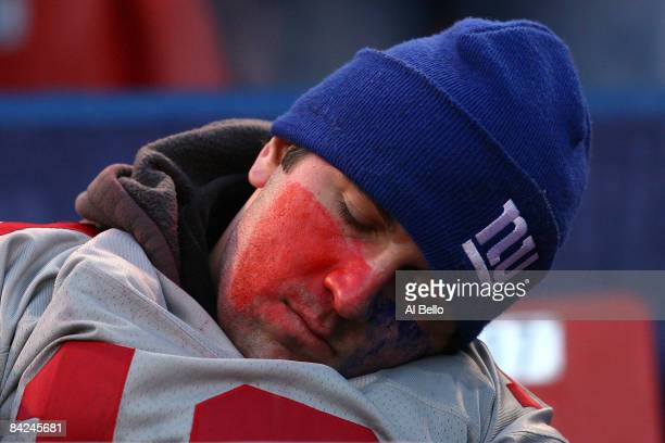 A fan of the New York Giants sleeps during a game against the Philadelphia Eagles during the NFC Divisional Playoff Game on January 11 2009 at Giants...