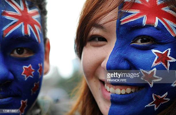 A fan of the New Zealand All Blacks smile during a traditional Maori welcome during the team's official welcoming ceremony in Auckland on September 3...
