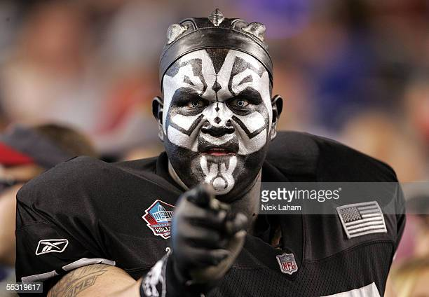 A fan of the Oakland Raiders cheers before the 2005 NFL opening game against the New England Patriots at Gillette Stadium on September 8 2005 in...
