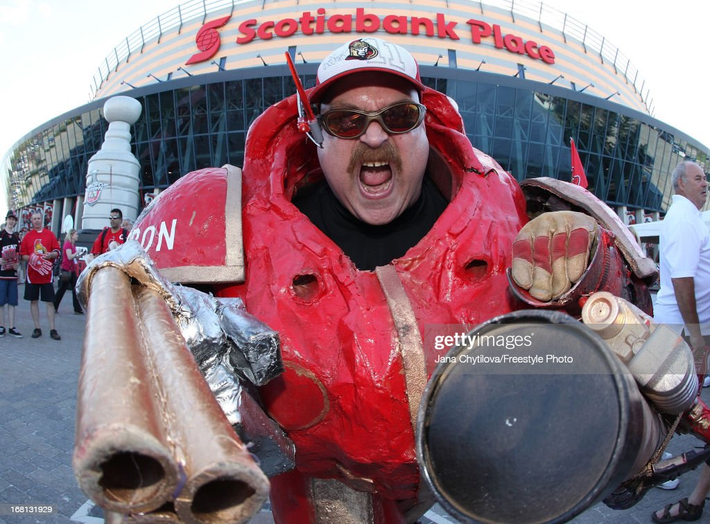 A fan of the Ottawa Senators enjoys the atmosphere outside the arena prior to the start of a game between the Ottawa Senators and the Montreal Canadiens for Game Three of the Eastern Conference Quarterfinals during the 2013 NHL Stanley Cup Playoffs at Scotiabank Place, on May 5, 2013 in Ottawa, Ontario, Canada.