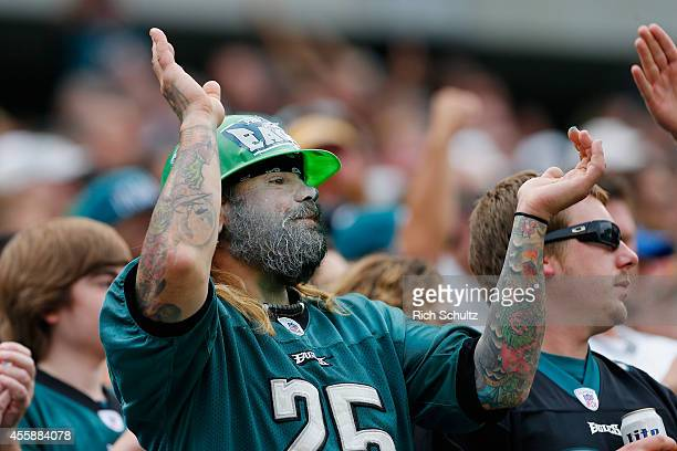 A fan of the Philadelphia Eagles cheers against the Washington Redskins in the third quarter at Lincoln Financial Field on September 21 2014 in...