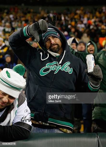 A fan of the Philadelphia Eagles reacts during the fourth quarter against the Green Bay Packers at Lambeau Field on November 16 2014 in Green Bay...
