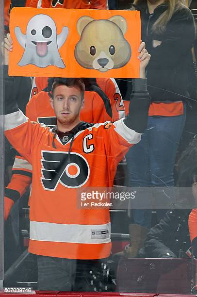 A fan of the Philadelphia Flyers holds up a sign depicting Shayne Gostisbehere emojis during warmups prior to a NHL game against the Toronto Maple...