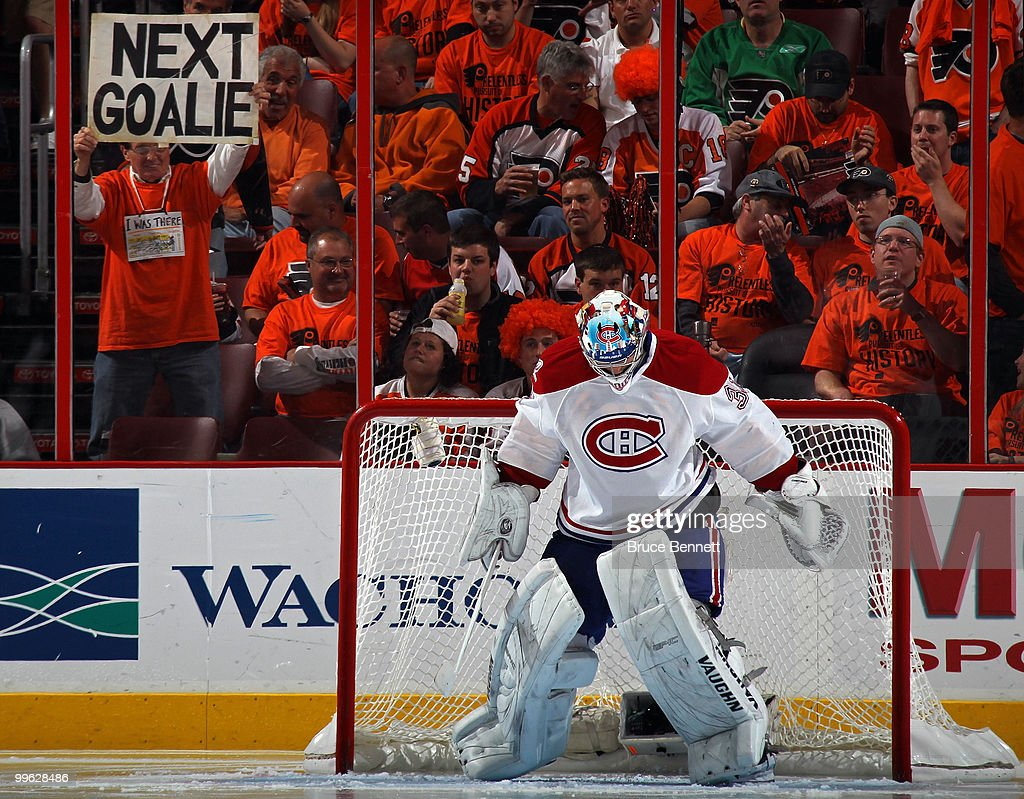A fan of the Philadelphia Flyers holds up a sign reading 'Next Goalie' behind goalie Carey Price #32 of the Montreal Canadiens in Game 1 of the Eastern Conference Finals during the 2010 NHL Stanley Cup Playoffs at Wachovia Center on May 16, 2010 in Philadelphia, Pennsylvania.