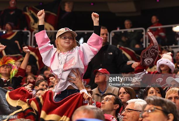 A fan of the Phoenix Coyotes cheers during the NHL game against the Los Angeles Kings at Jobingcom Arena on December 26 2009 in Glendale Arizona The...