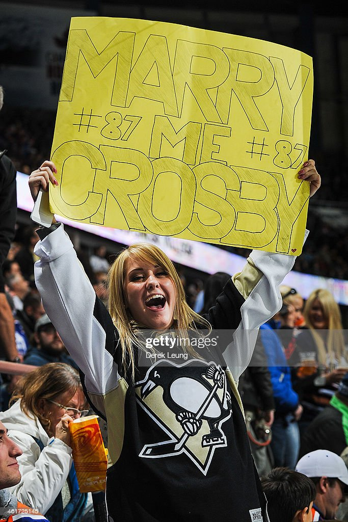 A fan of the Pittsburgh Penguins celebrates after Sidney Crosby (not pictured) scored the team's second goal against the Edmonton Oilers during an NHL game at Rexall Place on January 10, 2014 in Edmonton, Alberta, Canada.