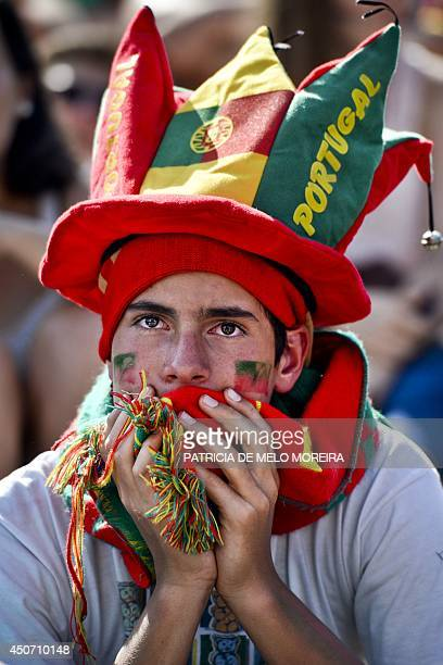 A fan of the Portugal national football team watches in Eduardo VII Park in Lisbon on June 16 2014 the FIFA World Cup 2014 match Germany vs Portugal...