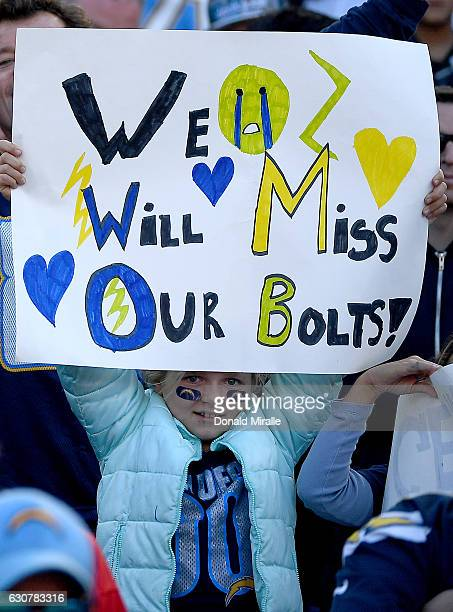 A fan of the San Diego Chargers holds a sign en route to the Charger's 3727 loss to the Kansas City Chiefs during their NFL game at Qualcomm Stadium...