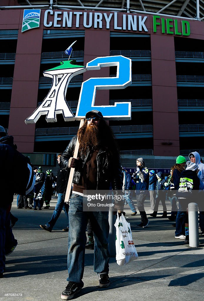 A fan of the Seattle Seahawks holds a sign during the Super Bowl XLVIII Victory Parade at CenturyLink Field on February 5, 2014 in Seattle, Washington.