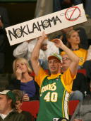 A fan of the Seattle SuperSonics holds a sign prior to the game against the Phoenix Suns on November 1 2007 at Key Arena in Seattle Washington The...