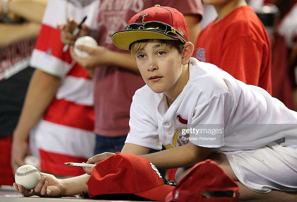 A fan of the St. Louis Cardinals looks for autographs before the MLB Opening Day game against the Arizona Diamondbacks at Chase Field on April 1, 2013 in Phoenix, Arizona.