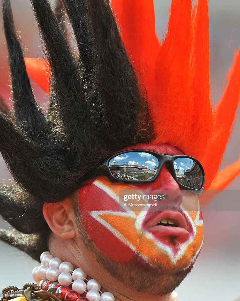 A fan of the Tampa Bay Buccaneers watches play against the Arizona Cardinals September 29, 2013 at Raymond James Stadium in Tampa, Florida.
