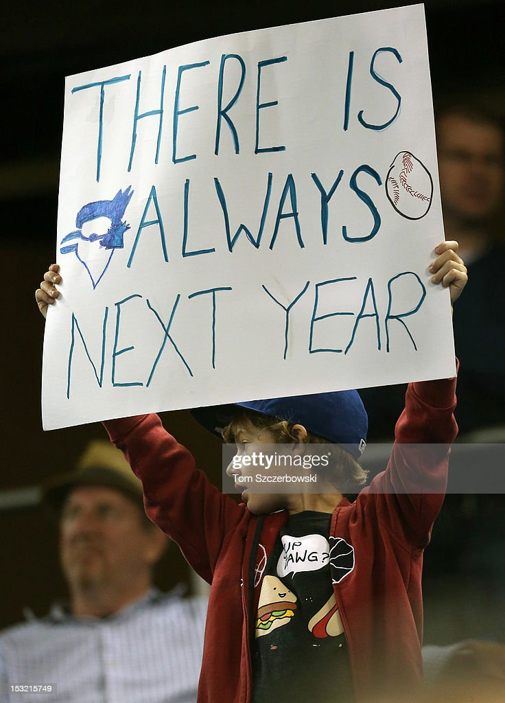 A fan of the Toronto Blue Jays holds a sign during MLB game action against the Minnesota Twins on October 1, 2012 at Rogers Centre in Toronto, Ontario, Canada.