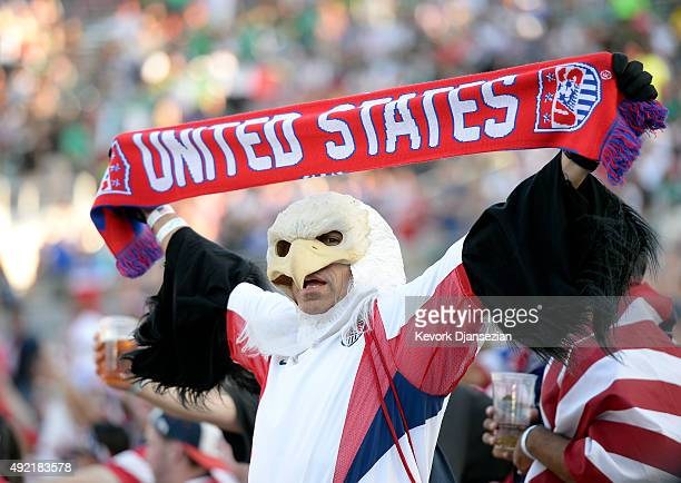 A fan of the United States dressed as an eagle holds a scarf inside the Rose Bowl before the start of 2017 FIFA Confederations Cup Qualifier against...