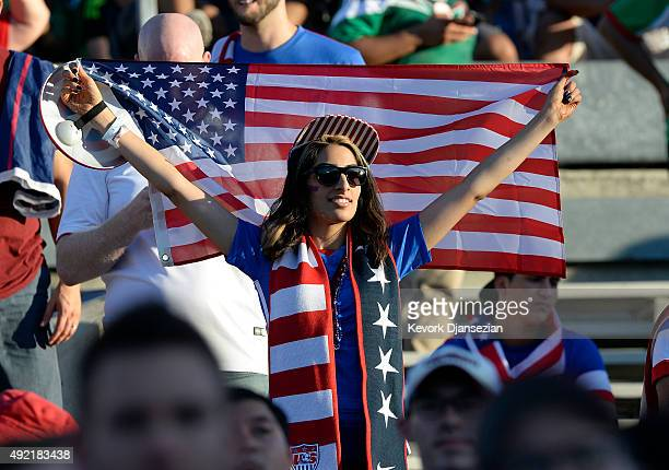 A fan of the United States holds an American flag inside the Rose Bowl before the start of 2017 FIFA Confederations Cup Qualifier at Rose Bowl on...
