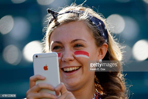A fan of the United States takes a picture with her IPhone before the USA takes on Colombia in the FIFA Women's World Cup 2015 Round of 16 match at...