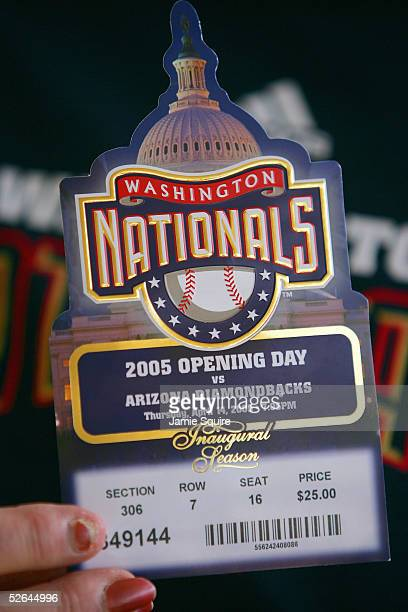 A fan of the Washington Nationals hold up a game day ticket before the teams home opener against Arizona Diamondbacks on April 14 2005 at RFK Stadium...