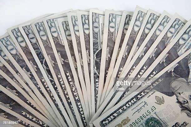 A fan of twenty dollar bills