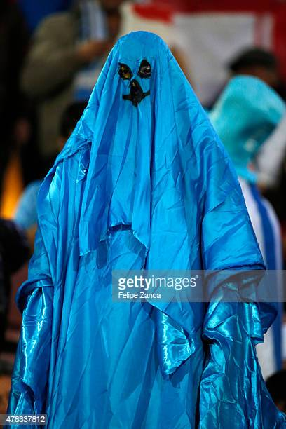 A fan of Uruguay disguised as a phantom enjoys the atmosphere prior the 2015 Copa America Chile quarter final match between Chile and Uruguay at...