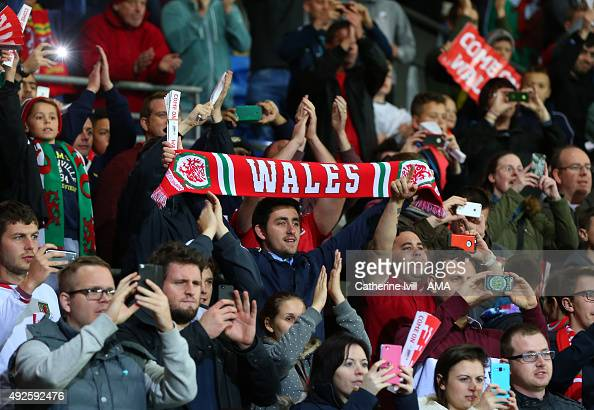 A fan of Wales holds up a scarf during the UEFA EURO 2016 Qualifier match between Wales and Andorra at Cardiff City Stadium on October 13 2015 in...