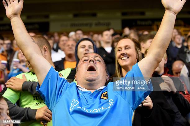 A fan of Wolverhampton Wanderers celebrates during the EFL Cup match between Wolverhampton Wanderers and Crawley Town at Molineux on August 8 2016 in...