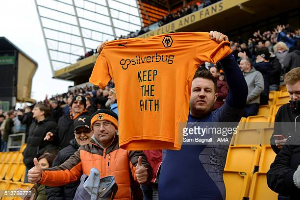 A fan of Wolverhampton Wanderers holds up a shirt saying KEEP THE FAITH during the Sky Bet Championship match between Wolverhampton Wanderers and...