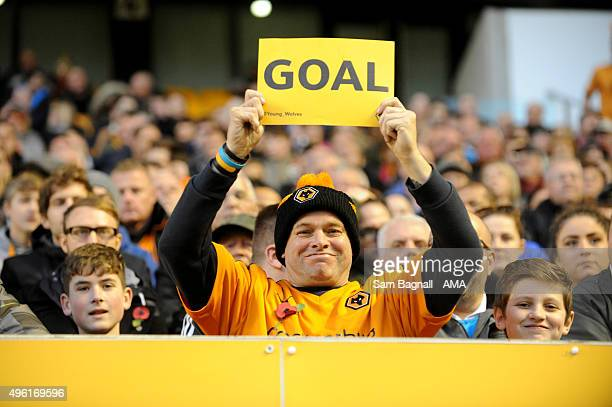 A fan of Wolverhampton Wanderers holds up a sign saying goal during the Sky Bet Championship match between Wolverhampton Wanderers and Burnley at...