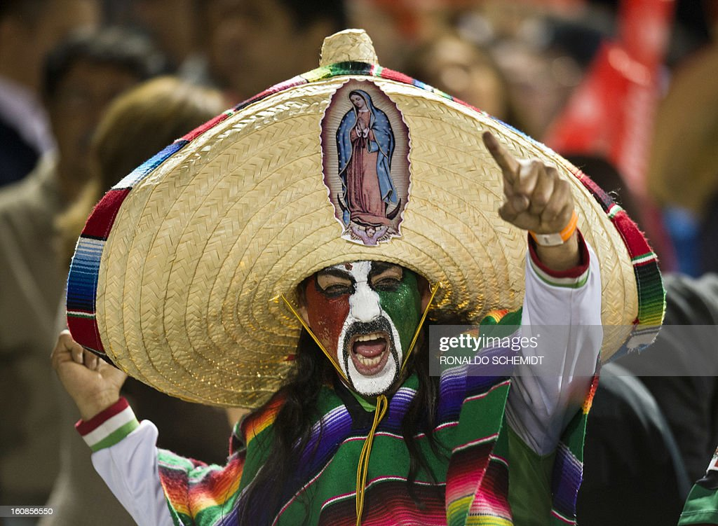 A fan of Yaquis de Obregon of Mexico cheers in a match against Criollos de Caguas of Puerto Rico during the 2013 Caribbean baseball series on February 6, 2013 in Hermosillo in the northern Mexican state of Sonora. The Mexican team won 10-0. AFP PHOTO/Ronaldo Schemidt
