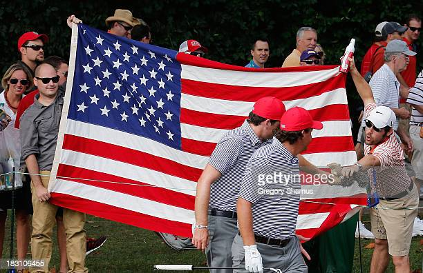 A fan offers a toy squirrel to Keegan Bradley and Phil Mickelson of the US Team on the second hole during the Day Two Foursome Matches at the...
