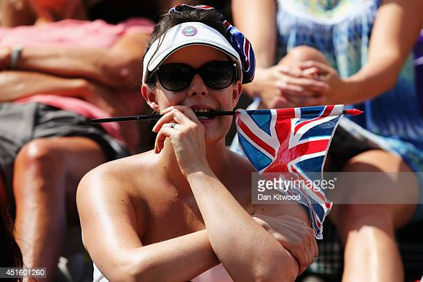 Fan on Murray mound looks on dejected as she watches Andy Murray lose against Grigor Dimitrov on day nine the Wimbledon Lawn Tennis Championships at...