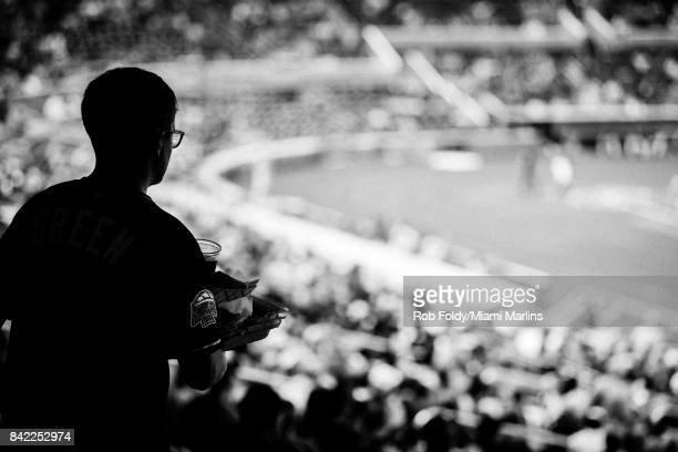 Fan on the promenade level during the second inning of the game between the Miami Marlins and the Philadelphia Phillies at Marlins Park on September...