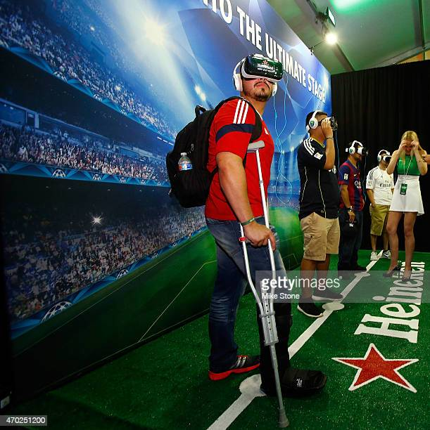 A fan participates in a virtual reality exhibit at the 2015 UEFA Champions League Trophy Tour presented by Heineken exhibition on April 18 2015 in...