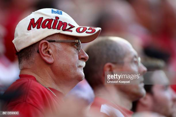 A fan pf Mainz is seen during the Bundesliga match between 1 FSV Mainz 05 and Hamburger SV at Opel Arena on October 14 2017 in Mainz Germany