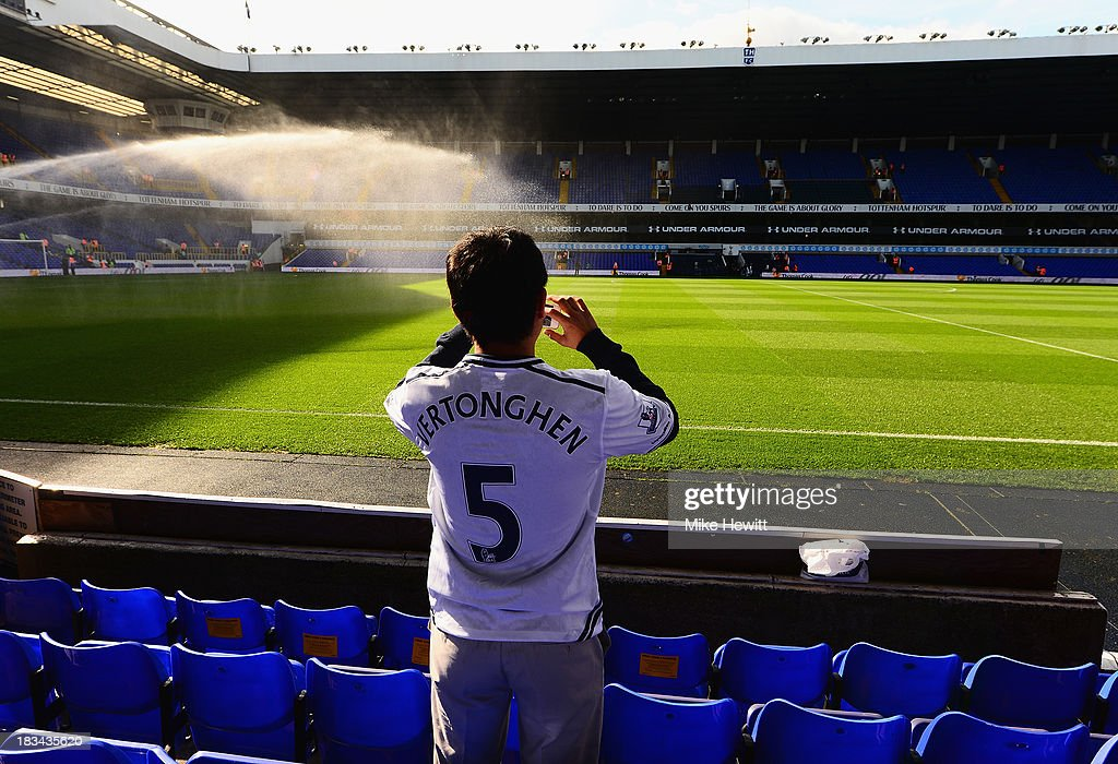 A fan photographs the pitch ahead of the Barclays Premier League match between Tottenham Hotspur and West Ham United at White Hart Lane on October 6, 2013 in London, England.
