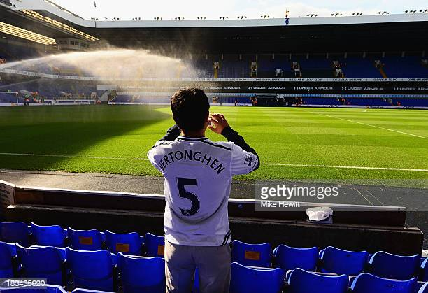 A fan photographs the pitch ahead of the Barclays Premier League match between Tottenham Hotspur and West Ham United at White Hart Lane on October 6...