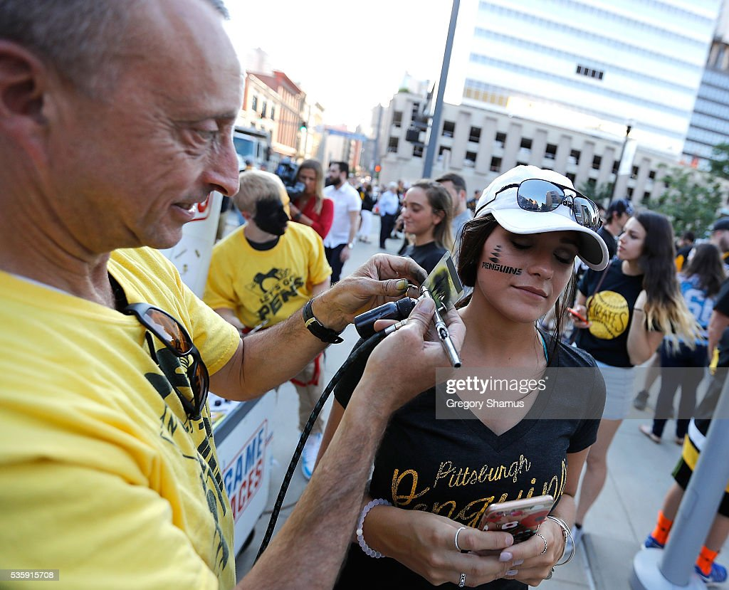 A fan play gets her face painted prior to Game One of the 2016 NHL Stanley Cup Final between the San Jose Sharks and the Pittsburgh Penguins at Consol Energy Center on May 30, 2016 in Pittsburgh, Pennsylvania.