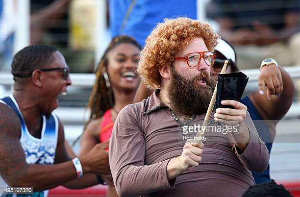 A fan plays a cowbell in the stands during the second half of the game between the Florida Atlantic Owls and the FIU Golden Panthers at FAU Stadium...