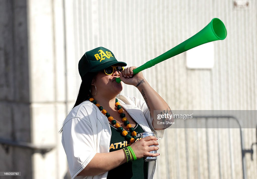 A fan plays a vuvuzela on her way to the stadium for the Oakland Athletics game against the Seattle Mariners on Opening Day at O.co Coliseum on April 1, 2013 in Oakland, California.