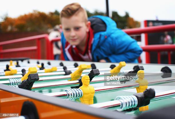 A fan plays table football prior to the Barclays Premier League match between Sunderland and Newcastle United at Stadium of Light on October 25 2015...