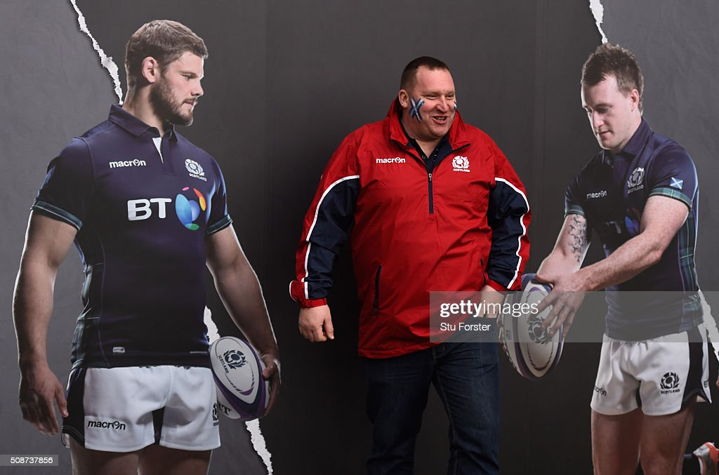 A fan poses alongside images of Ross Ford and <a gi-track='captionPersonalityLinkClicked' href=/galleries/search?phrase=Stuart+Hogg+-+Rugby+Player&family=editorial&specificpeople=8947952 ng-click='$event.stopPropagation()'>Stuart Hogg</a> of Scotland prior to kickoff during the RBS Six Nations match between Scotland and England at Murrayfield Stadium on February 6, 2016 in Edinburgh, Scotland.