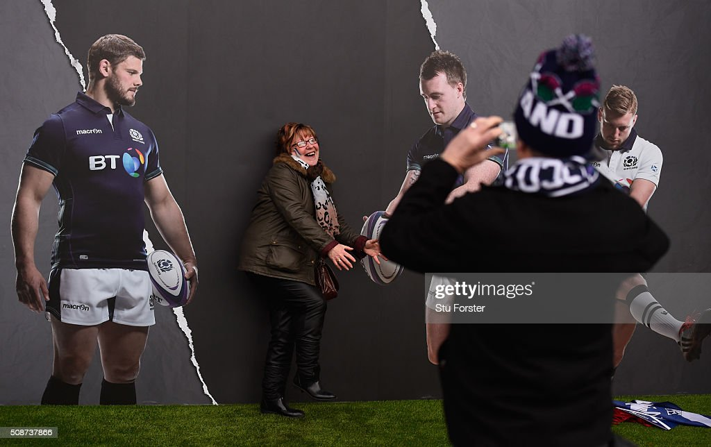 A fan poses alongside images of Ross Ford and Stuart Hogg of Scotland prior to kickoff during the RBS Six Nations match between Scotland and England at Murrayfield Stadium on February 6, 2016 in Edinburgh, Scotland.