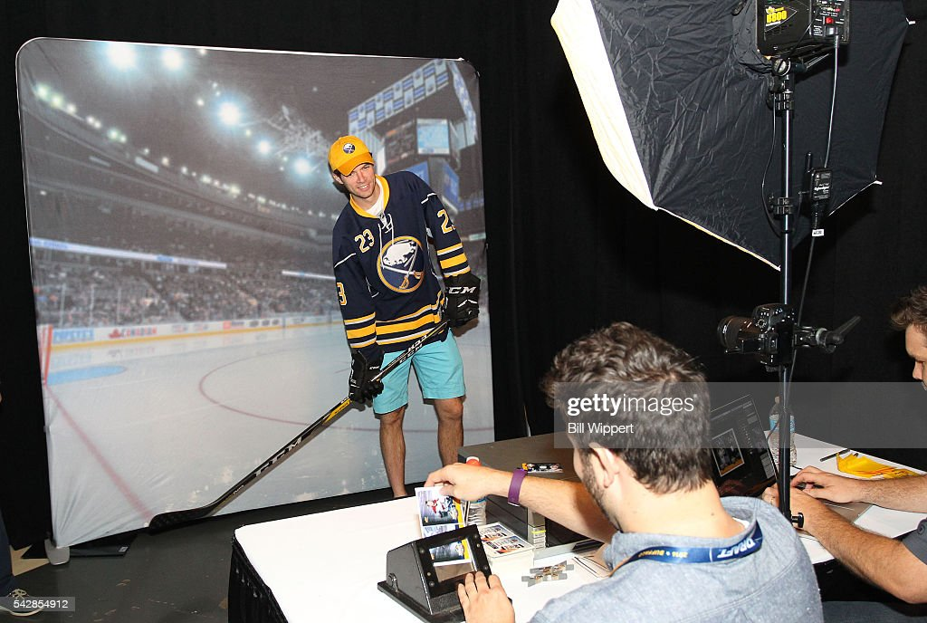 A fan poses for a photo in a booth prior to round one of the 2016 NHL Draft at First Niagara Center on June 24, 2016 in Buffalo, New York.